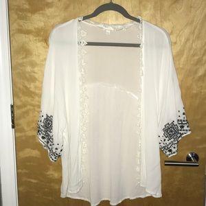 White kimono with black detail on sleeves